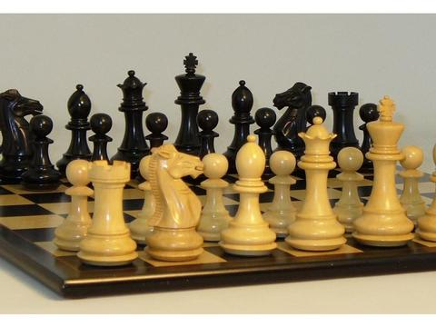Black and Boxwood Exclusive Chessmen with Black Birdseye Maple Chess Board